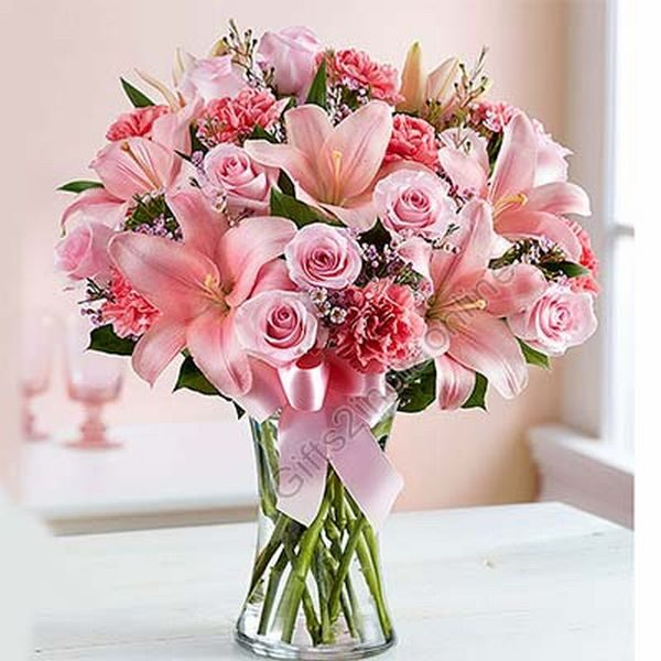 8 gerberas, 8 roses, and 2 stem pink lilies