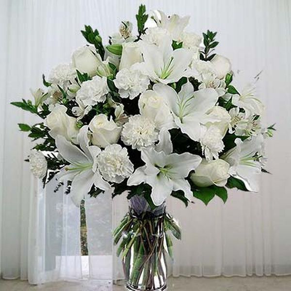 10 White Carnations with 6 white roses and 2 stems of white lily